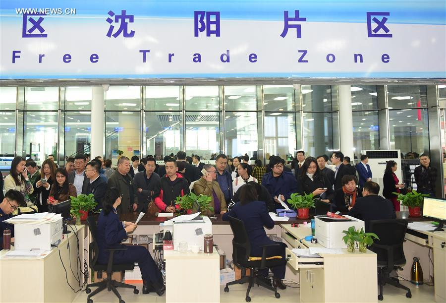 People enquire at the service hall of the Shenyang area of China (Liaoning) Pilot Free Trade Zone in Shenyang, capital of northeast China