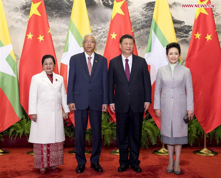 Chinese President Xi Jinping (2nd R) and his wife Peng Liyuan (1st R) pose for a photo with Myanmar President U Htin Kyaw (2nd L) and his wife in Beijing, capital of China, April 10, 2017. Xi held a welcome ceremony for Myanmar President U Htin Kyaw before their talks here on Monday. (Xinhua/Li Xueren)