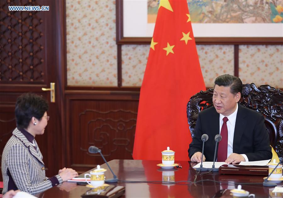 Chinese President Xi Jinping (R) meets with Lam Cheng Yuet-ngor, the newly appointed chief executive of the Hong Kong Special Administrative Region (HKSAR), in Beijing, capital of China, April 11, 2017. (Xinhua/Ju Peng)