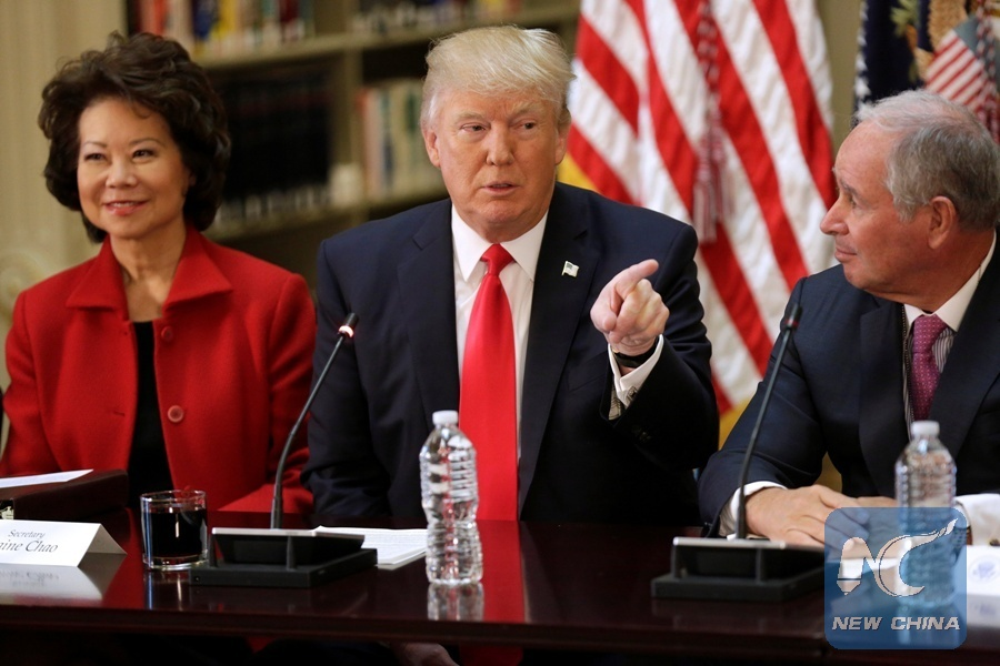 U.S. President Donald Trump speaks during a strategic and policy CEO discussion as Secretary of Transportation Elaine Chao and CEO of Blackstone Stephen Schwarzman listen in the Eisenhower Execution Office Building in Washington, the United States, April 11, 2017. (Xinhua/REUTERS)
