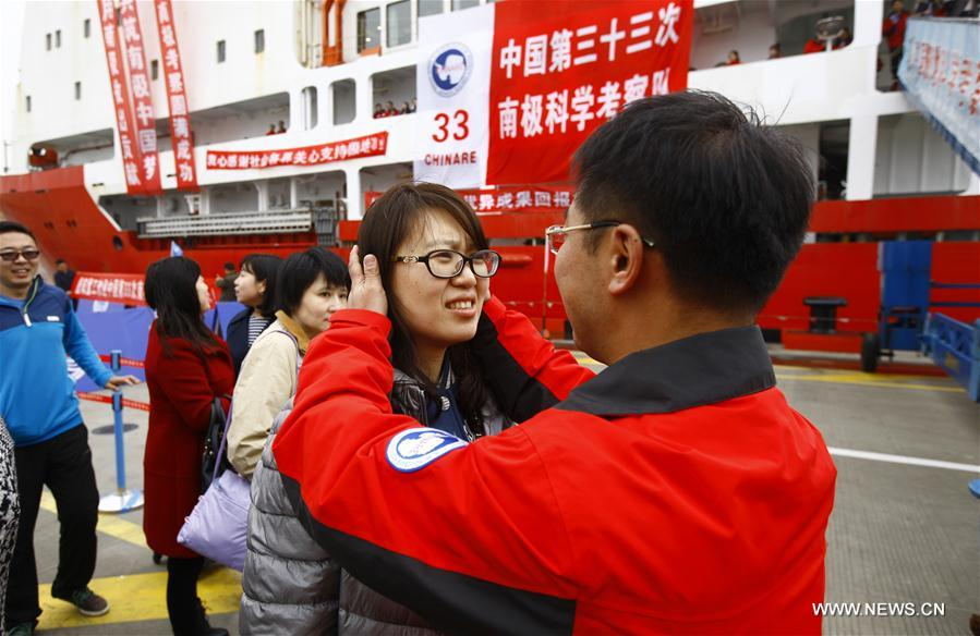 Zhang Nan (R), a member of the Chinese scientific expedition team, hugs his wife after returning to Shanghai, east China, April 11, 2017. Chinese scientists concluded a 161-day expedition, the 33rd of its kind, to Antarctica on the Xuelong icebreaker and returned to Shanghai on Tuesday. (Xinhua/Fang Zhe)