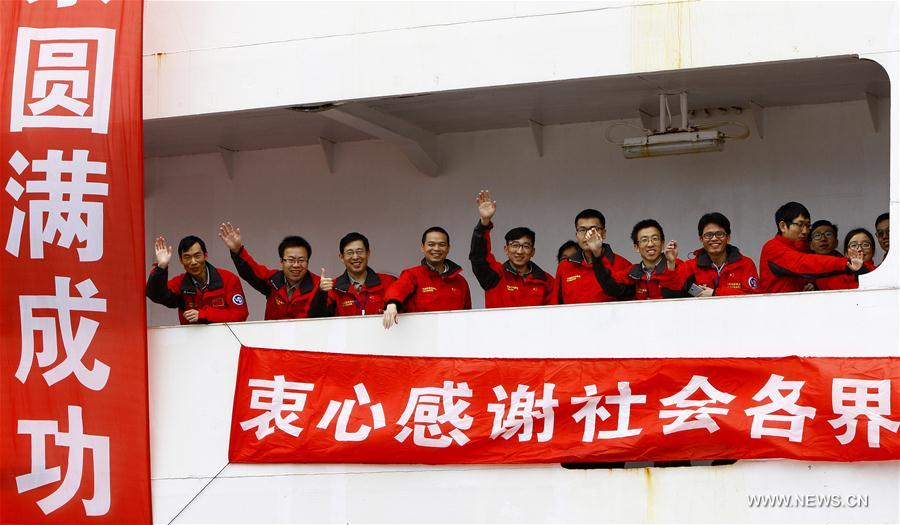 Members of the Chinese scientific expedition team wave after returning to Shanghai, east China, April 11, 2017. Chinese scientists concluded a 161-day expedition, the 33rd of its kind, to Antarctica on the Xuelong icebreaker and returned to Shanghai on Tuesday. (Xinhua/Fang Zhe)