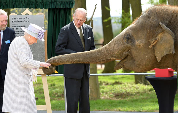 Queen Elizabeth II plays with her namesake baby elephant