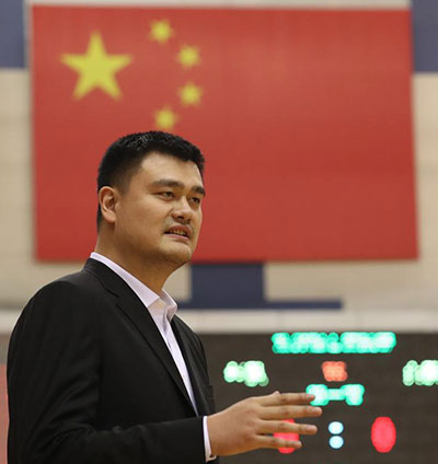 Chairman of the Chinese Basketball Association Yao Ming speaks after an open training class of Chinese women