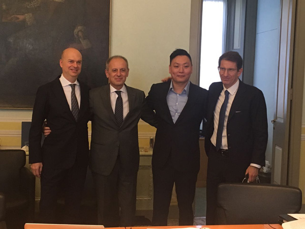 Representatives from Rossoneri Sport Investment Lux and Finivest during the signing ceremomy. [Photo provided to chinadaily.com.cn]