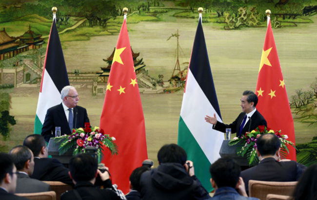 Chinese Foreign Minister Wang Yi (R) meets the press after talks with Palestinian Foreign Minister Riyad al-Malki in Beijing, capital of China, April 13, 2017. [Photo: gov.cn]