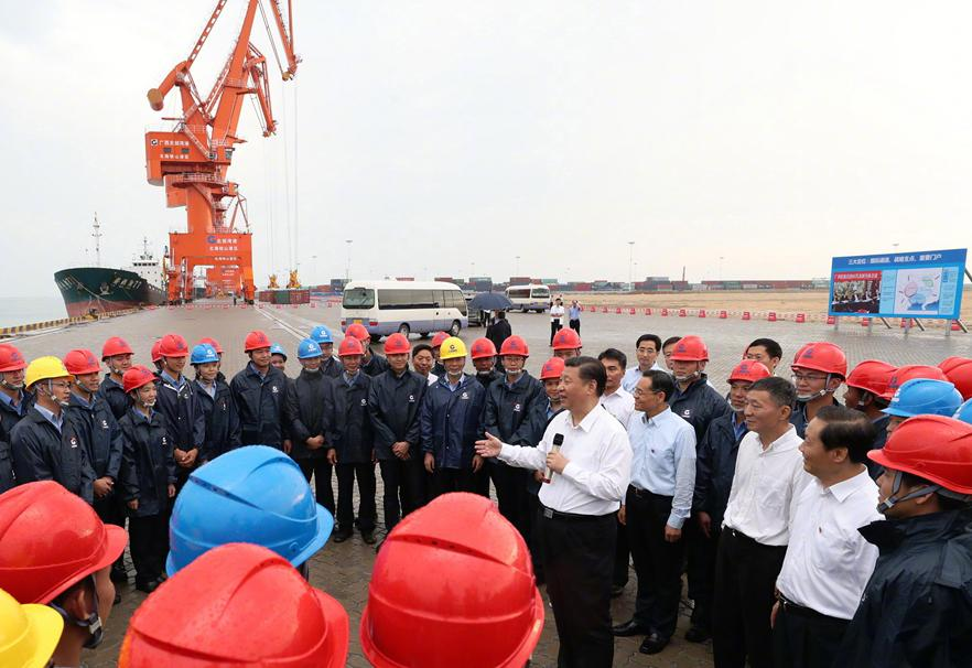 President Xi Jinping talks with workers at the Tieshangang Yard in Beihai, South China