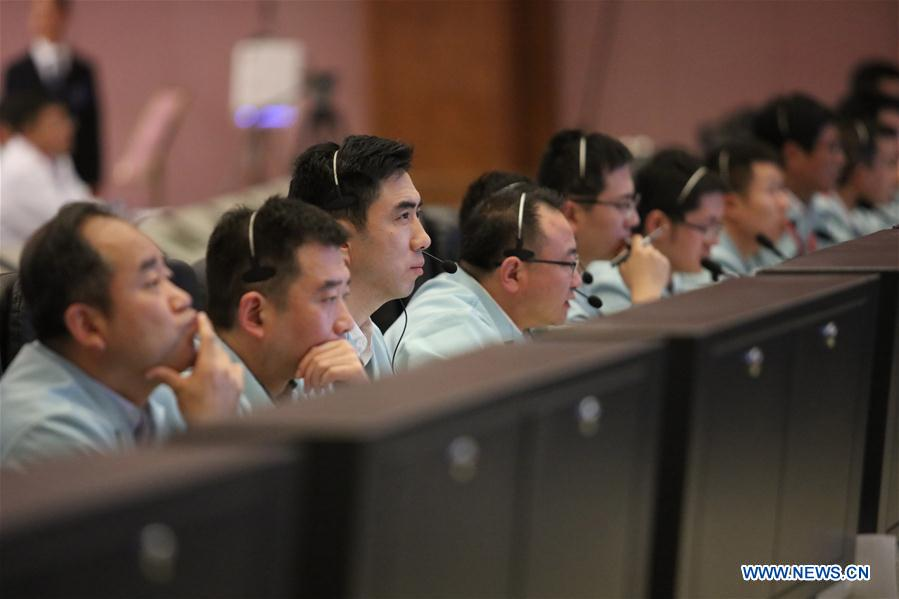 Technical personnel work at Beijing Aerospace Control Center to monitor the automated docking between Tianzhou-1 cargo spacecraft and Tiangong-2 space lab in Beijing, capital of China, April 22, 2017. The Tianzhou-1 cargo spacecraft, China