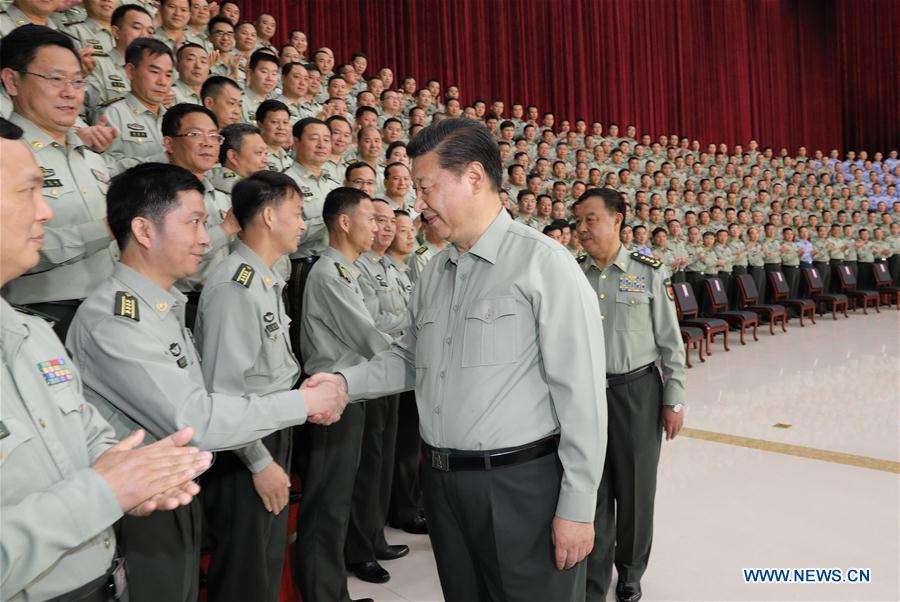 Chinese President Xi Jinping, who is also general secretary of the Communist Party of China (CPC) Central Committee and chairman of the Central Military Commission (CMC), meets with military officers during an inspection of the Southern Theater Command of the People