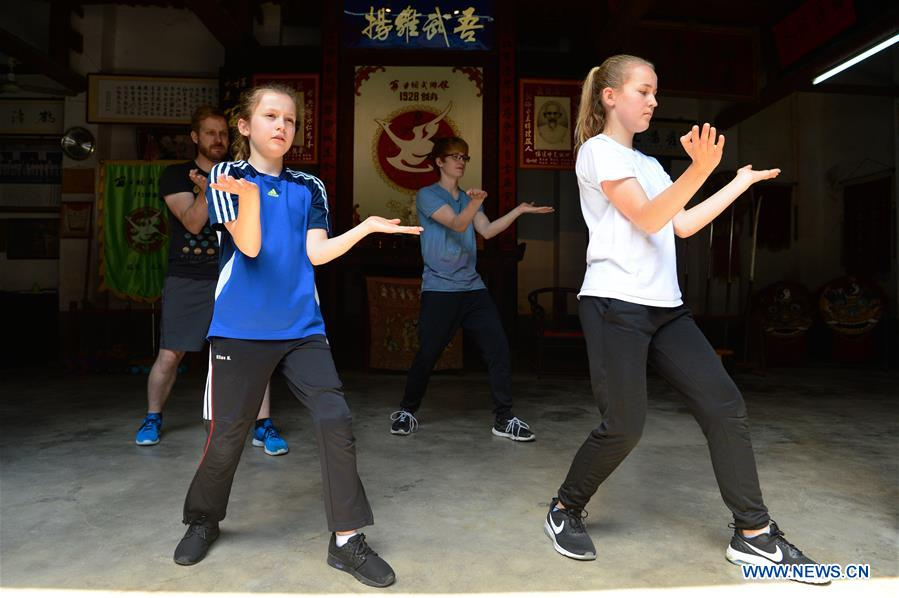 Niewerth Luise (L front) and her family members pracitce at Wenggongci martial art club in Yongchun, East China