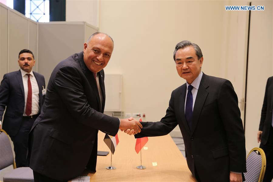 Chinese Foreign Minister Wang Yi (R, front) shakes hands with his Egyptian counterpart Sameh Shoukry (L, front) during their meeting on the sidelines of the Ancient Civilization Forum in Athens, Greece, on April 24, 2017. (Xinhua/Lefteris Partsalis)