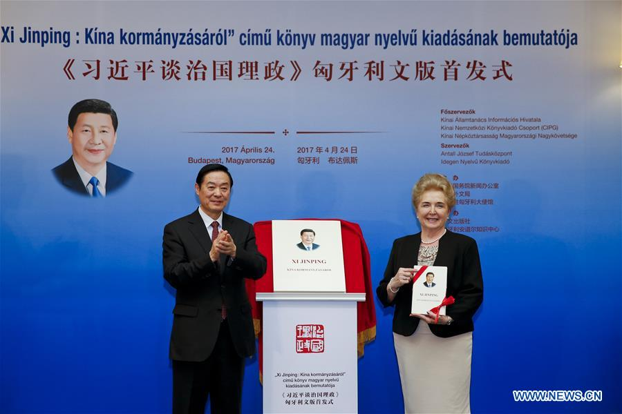 Liu Qibao (L), member of the Political Bureau of the Central Committee of the Communist Party of China (CPC) and head of the Publicity Department of the CPC Central Committee, and Matrai Marta, executive vice chairman of the Hungarian National Assembly, attend the release ceremony of the Hungarian version of Chinese President Xi Jinping