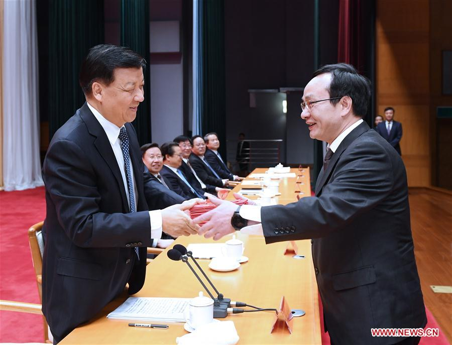 Liu Yunshan (L), president of the Party School of the Communist Party of China (CPC) Central Committee and member of the Standing Committee of the Political Bureau of the CPC Central Committee, awards certificates to a graduate during a spring semester graduation ceremony of the Party School in Beijing, capital of China, April 27, 2017. (Xinhua/Rao Aimin)