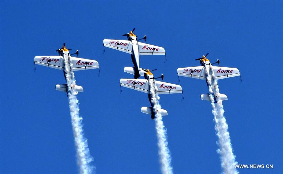 Aerobatic aircrafts fly during a performance at the Airshow Zhengzhou 2017 in Zhengzhou, capital of central China