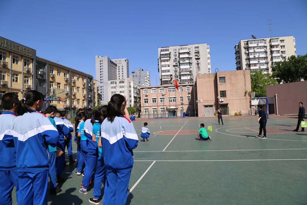 Students at Beijing Xicheng Foreign Languages School prepare to launch their rocket models on April 26, 2017.