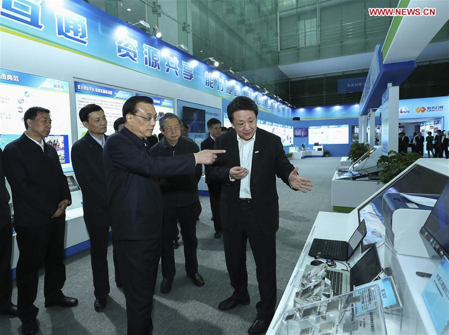 Chinese Premier Li Keqiang (C, front) inspects China Aerospace Science and Industry Corporation (CASIC) in Beijing, capital of China, April 27, 2017. (Xinhua/Xie Huanchi)