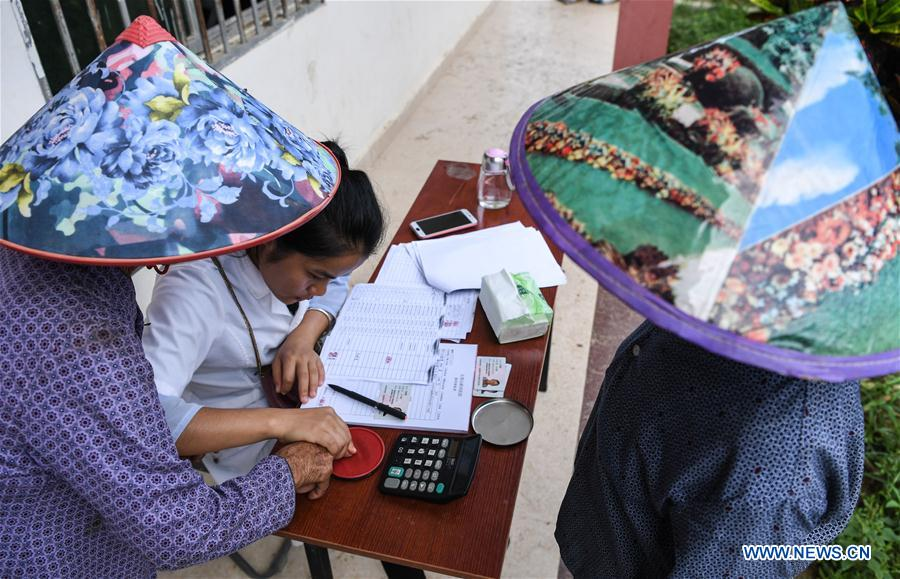 Villagers register for eye exams in Maozu Village in Wuzhishan City, south China