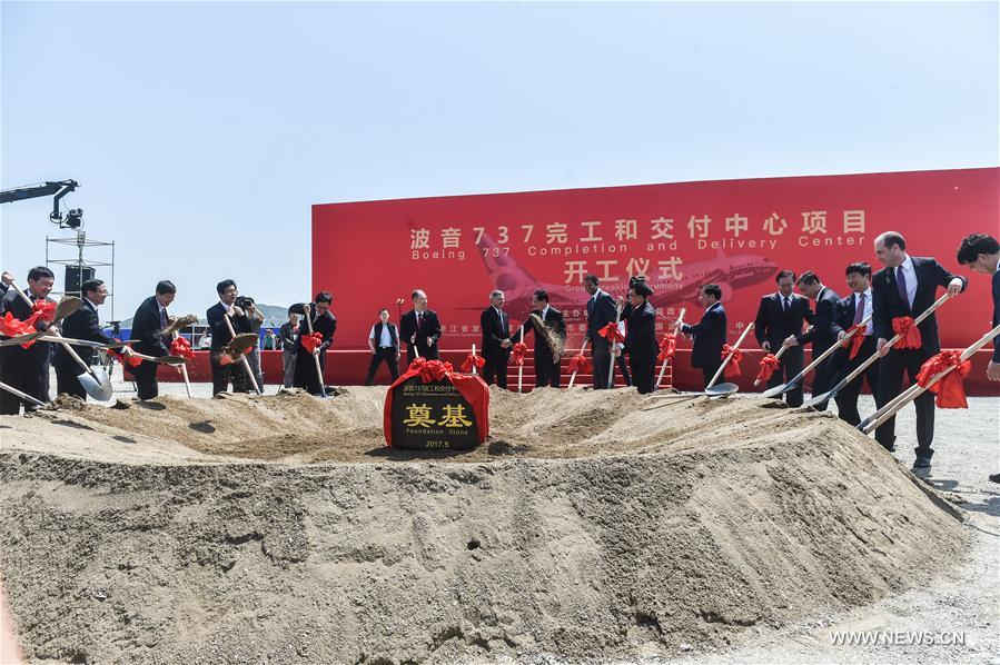 Delegates attend the groundbreaking ceremony of Boeing 737 Completion and Delivery Center in the Zhujiajian aviation industry park of Zhoushan, a port city in east China
