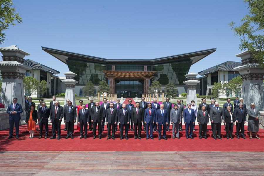 Chinese President Xi Jinping, foreign delegation heads and guests pose for a group photo at the Leaders