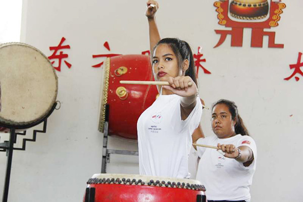 French students practice drumming in Taiyuan, North China