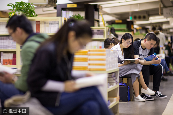 People read books at a book shop in Nanjing, East China