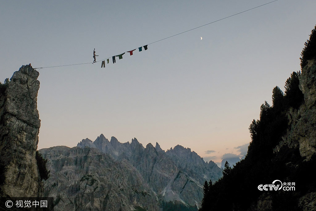 Fearless Paul Antoine Gauchon hangs his washing up on a line   higher than the tallest building in the world and then walks   across it. The thin rope is suspended at an incredible 3,215   ft in the air across a gorge in a Norwegian mountain range.