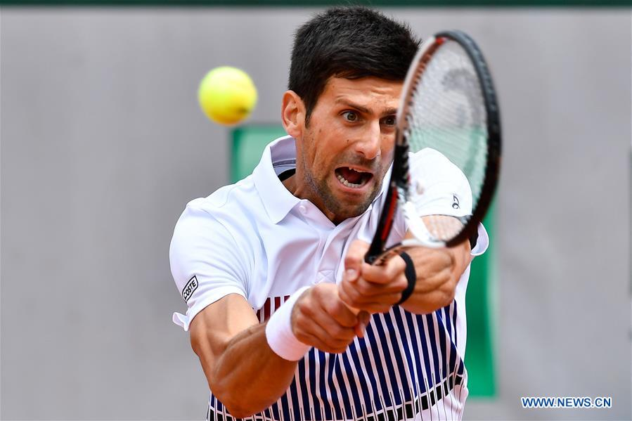 Novak Djokovic of Serbia hits a return during the men