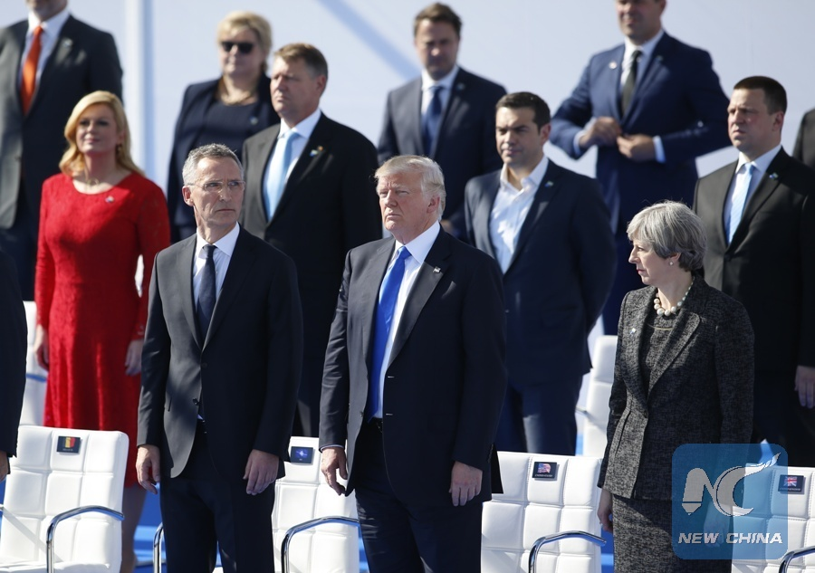 The file photo taken on May 25, 2017 shows that NATO Secretary General Jens Stoltenberg, U.S. President Donald Trump, British Prime Minister Theresa May (from L to R, front) and other NATO member states leaders attend the handover ceremony of the new NATO headquarters during a one-day NATO Summit, in Brussels, Belgium. (Xinhua/Ye Pingfan)