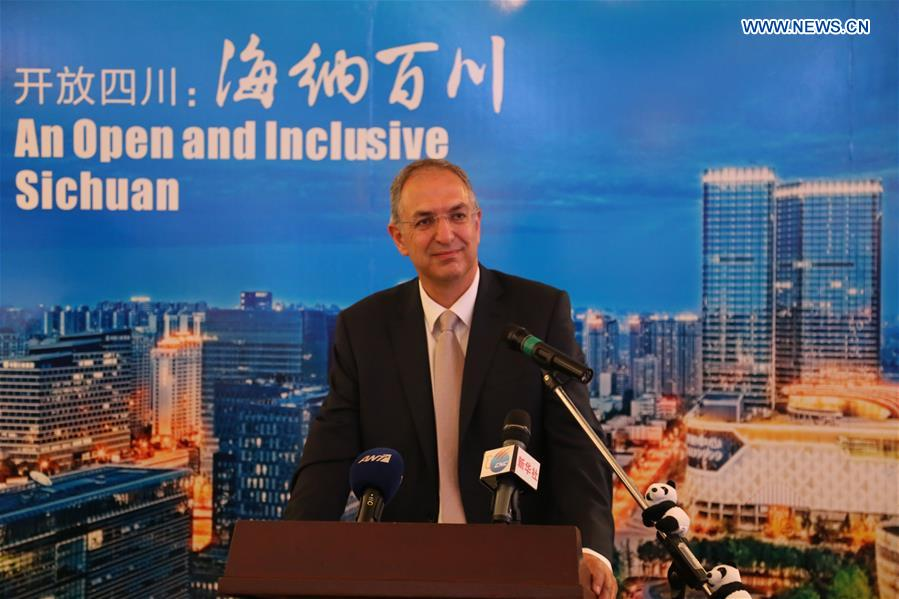 "Cypriot Education Minister Costas Kadis addresses the opening ceremony of the ""Heaven on Earth, Sichuan in your eyes"" photo exhibition of China"