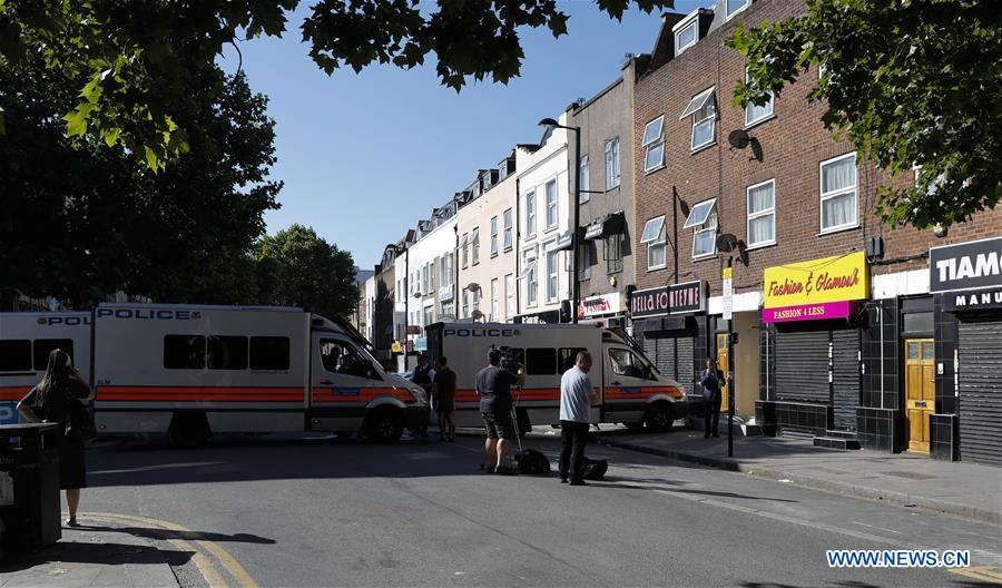 """Police block the area where a van ran into worshippers near a north London mosque, Britain, June 19, 2017. At least one was killed and 10 others were injured when a van was driven into worshippers early morning on Monday near a north London mosque in what police have called a """"major incident."""" (Xinhua/Han Yan)"""