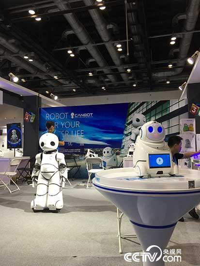 Photo shows humanoid commercial service robots CANBOT U05 being exhibited at 3E Beijing International Service Robot Exhibition 2017 on July 8.