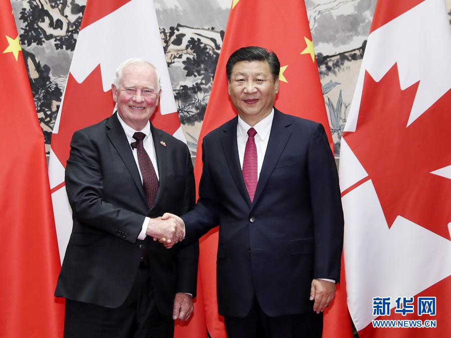 7月13日,国家主席习近平在北京钓鱼台国宾馆会见加拿大总督约翰斯顿。 新华社记者 丁林 摄