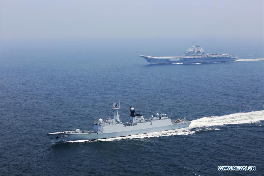 Une formation comportant un porte-avions chinois mène un entraînement de coordination