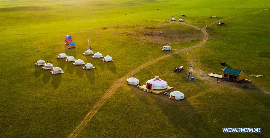 Photo taken on July 17, 2017 shows Mongolian yurts in Hulun Buir grassland, in north China