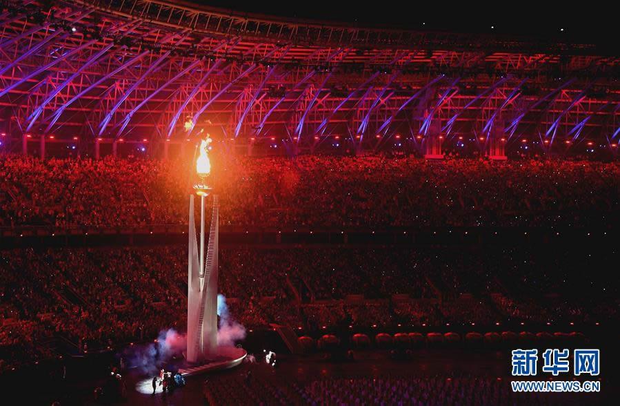 8月27日,第十三届全国运动会开幕式在天津奥林匹克中心体育场举行。 这是主火炬被点燃。 新华社记者赵戈摄