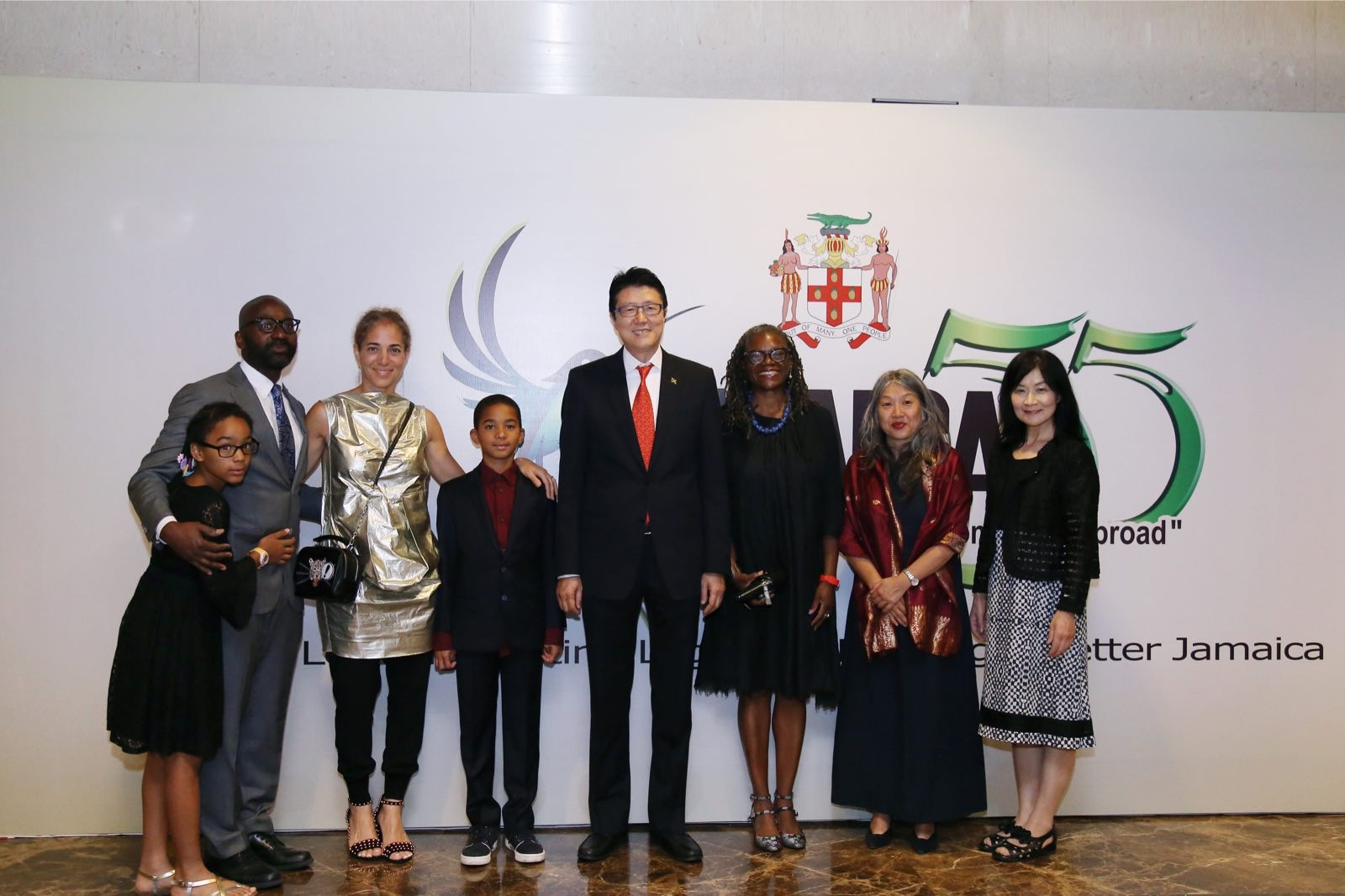 His Excellency, Antonia Hugh, Jamaican Ambassador to the P.R.C.  (4th right) shares lens time with Professor Deborah Thomas  (3rd left) film producer Jeanette Kong (2nd right) and other distinguished guests during the 55th Anniversary celebration of Jamaica