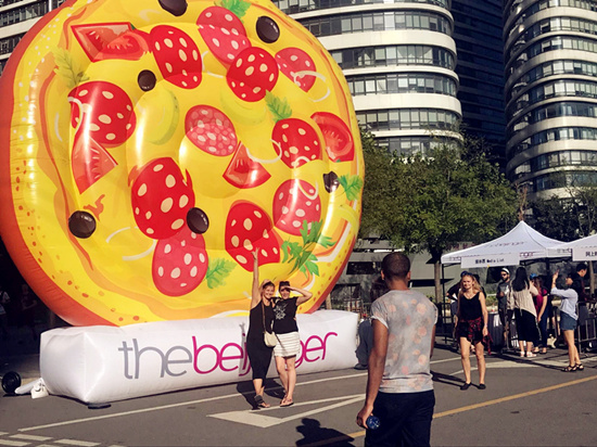 Big inflated pizza at the entrance. (Photo/ Qian Ding)