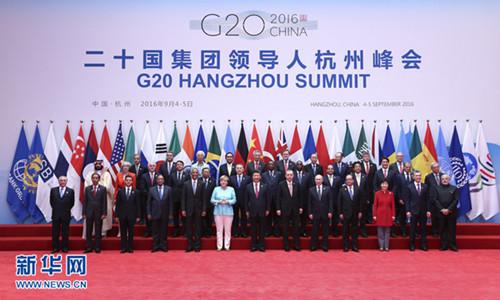 9月4日,二十国集团领导人第十一次峰会在杭州国际博览中心举行。国家主席习近平主持会议并致开幕辞。这是二十国集团成员和嘉宾国领导人、有关国际组织负责人集体合影。新华社记者庞兴雷摄