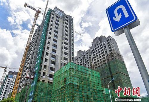 建设中的楼盘(资料图)。 中新社记者 骆云飞 摄