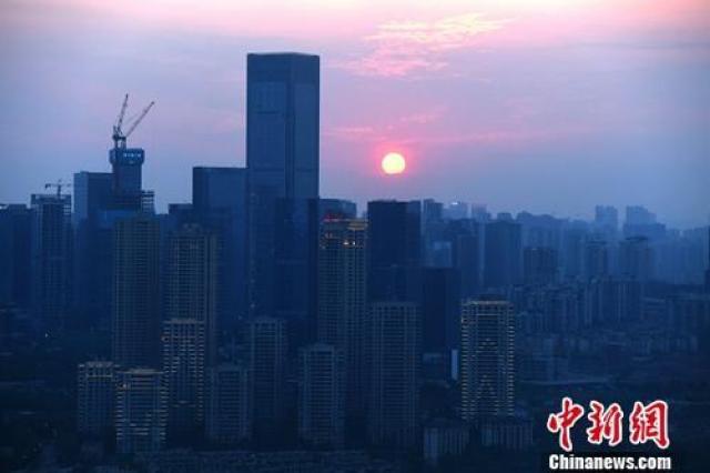 ↑资料图为重庆高楼。