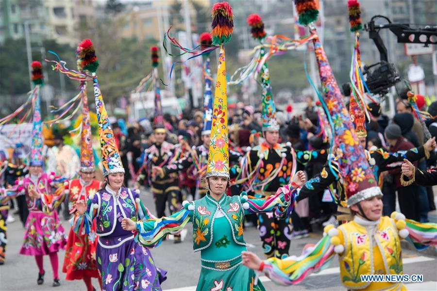 Performers take part in the Macao International Parade in Macao, south China, Dec. 17, 2017. The parade was held here on Sunday to mark the 18th anniversary of Macao