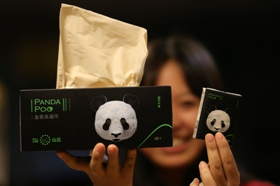 "A woman displays packages of ""Panda Poo"" tissues. Photo: VCG"