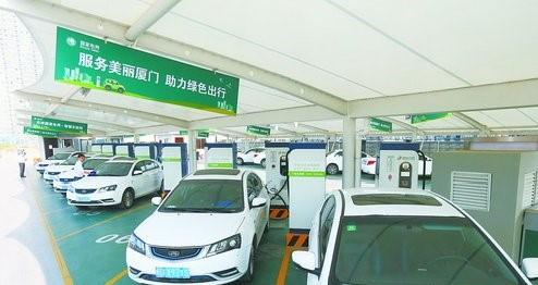 目前我市登记的新能源汽车有12000多辆。