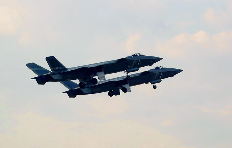 Two J-20 fighter jets conduct an exercise. LI SHAOPENG/XINHUA
