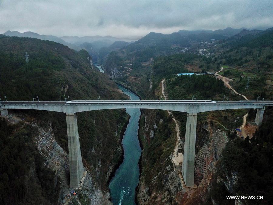 A bullet train runs through a bridge over Wujiang River, a tributary of China