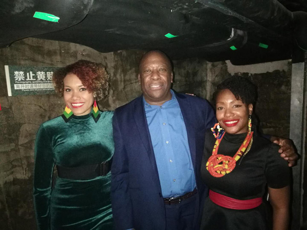 Denis Antoine (centre), Grenada's Ambassador to the PRC; Ayesha Wharton (right), Chargé d