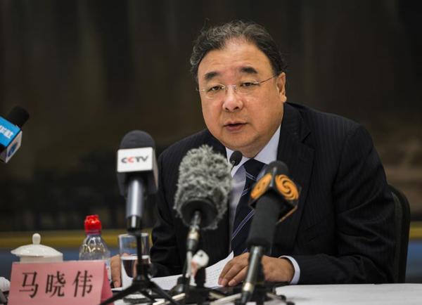 马晓伟主任在记者会上介绍中国参与全球卫生治理情况