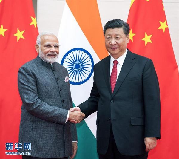 6月9日,国家主席习近平在青岛会见印度总理莫迪。新华社记者李学仁摄