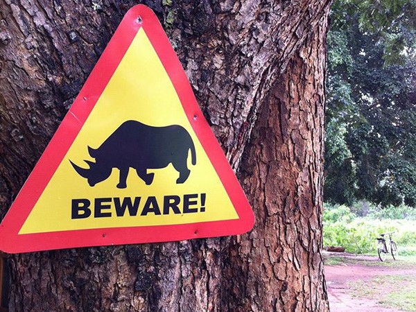 A public awareness notice to people visiting the park of Rhino crossing path ahead. (Photo/Timothy Sibasi)