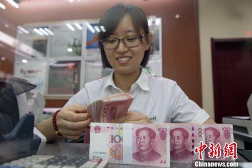 个税起征点提至5000元:少缴多少钱?谁最受益?